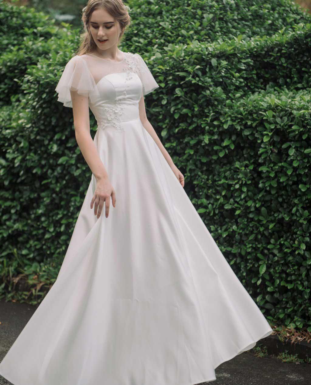 thiết kế tay áo cánh tiên -  Top những mẫu áo cưới đẹp nhất ai cũng muốn mặc.