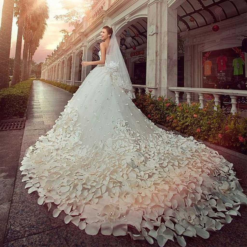 Kiểu áo cưới họa tiết hoa nổi Top những mẫu áo cưới đẹp nhất ai cũng muốn mặc.